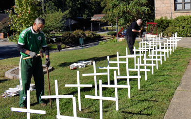 Dept. Grand Knight and Warden Bryan Clark putting up crosses