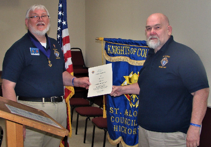 Grand Knight Eddie Williams awards Bryan Clark the Knight of the Month (May) Award