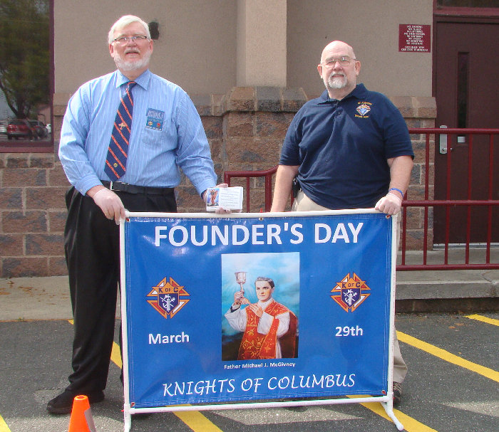 Grand Knight Eddie Williams, Knight Bryan Clark during Founder's Day event